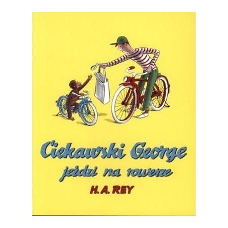 Ciekawski George jeździ na rowerze